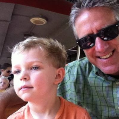 Father and son riding on the train
