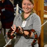 volunteer holding snake