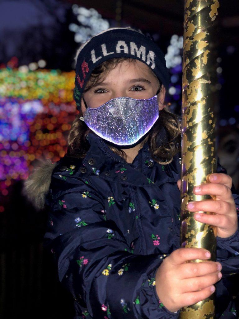 Girl wearing light up mask
