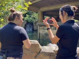 Angela Hatke and Jenna Wingate at the Cincinnati Zoo with hippo Fiona