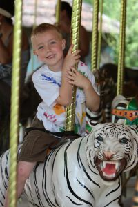 a kid on the carousel