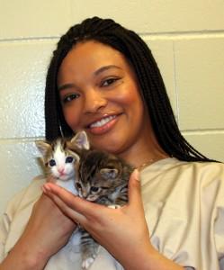 Vet student JaCiara Johnson with newborn kittens