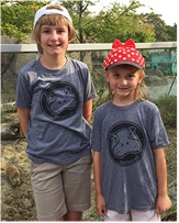 Guests proudly wear hippo t-shirts purchased to raise funds for hippo